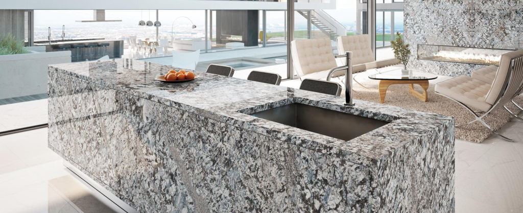 A kitchen island made out of granite stone